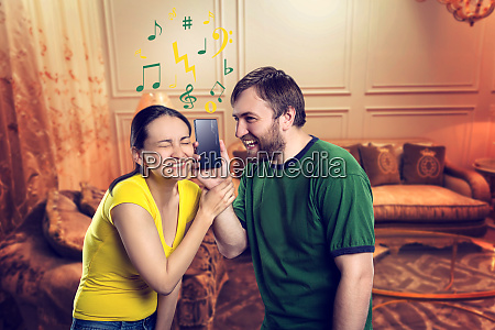 young, couple, listening, to, music - 28084031