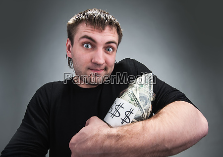 man with jar of dollars