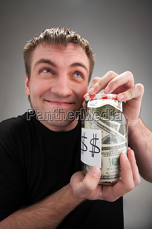 happy man with canned money