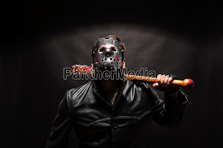 bloody maniac in mask and black