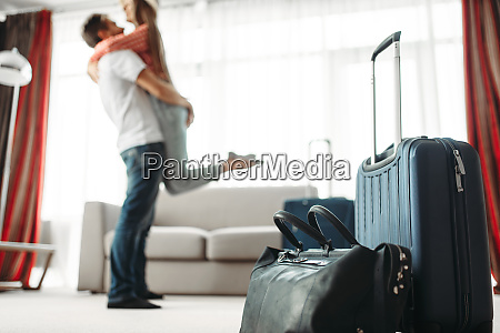 suitcases prepared for vacation happy couple