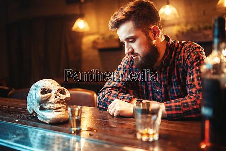 sad man at the bar counter