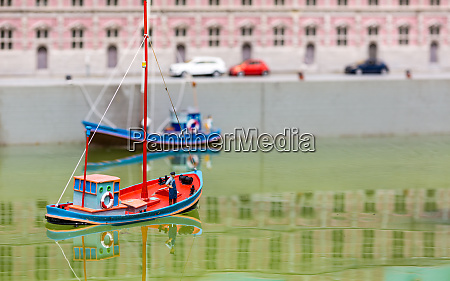 rescue boat rescuer and dog miniature