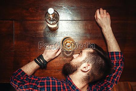 drunk man sleeps at the bar