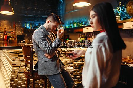 man lovingly looks on woman at