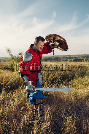 medieval knight with sword poses in
