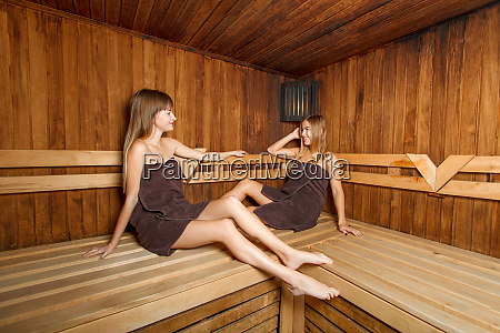 two beautiful females in sauna