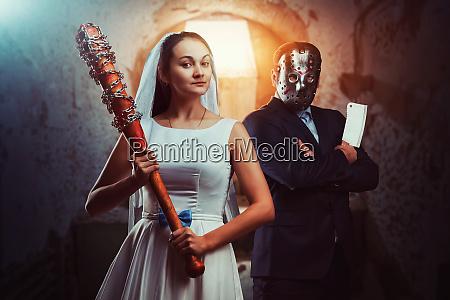 newlyweds maniacs old prison on background