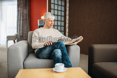 adult man sitting on couch and