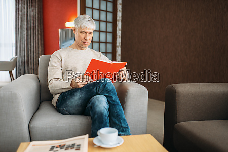 adult man with notebook sitting on