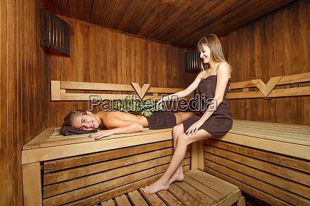 two females in a sauna