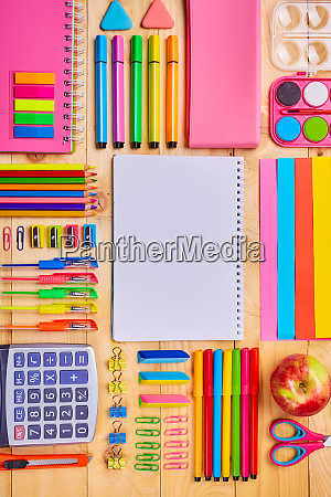 group of school supplies and notebooks