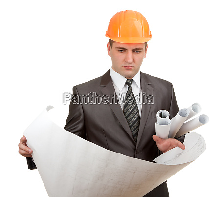 engineer in hardhat with plans