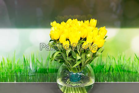 vase of yellow tulips in modern