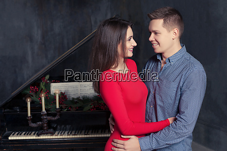 beautiful young loving couple embraces