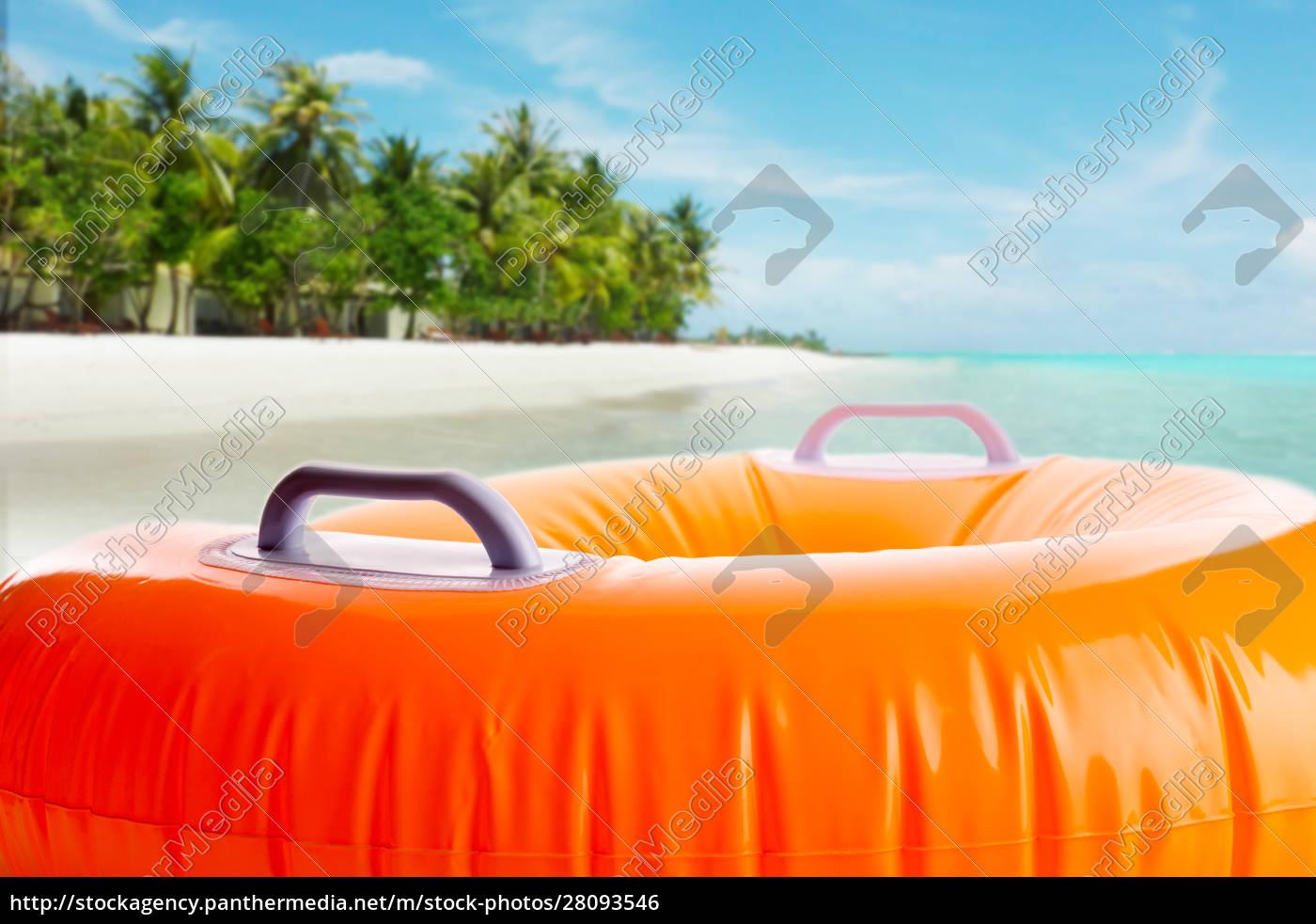 inflatable, orange, cushion, on, the, beach - 28093546