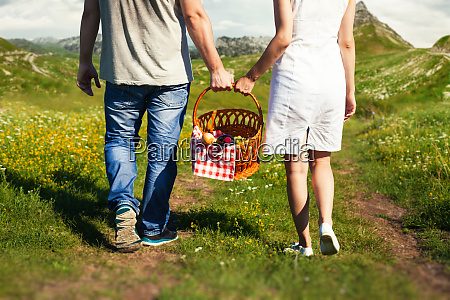 young couple going with picnic basket