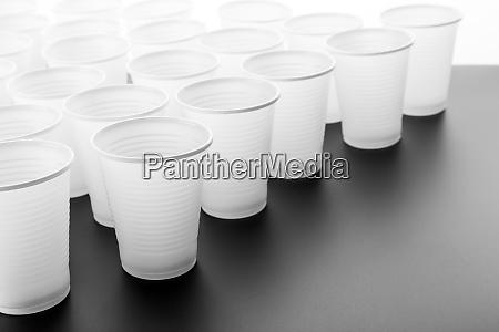 lots of plastic drinking glasses