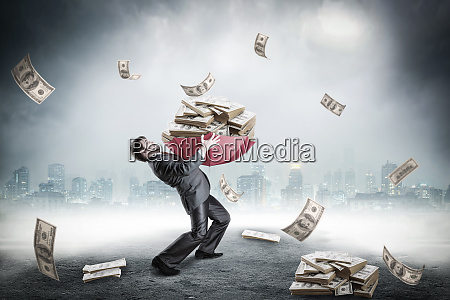 businessman loaded with huge amount of