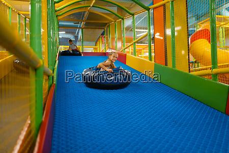girl rides on tubing entertainment center