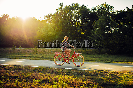 woman riding on vintage bicycle in