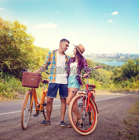 couple hugs on road vintage bike