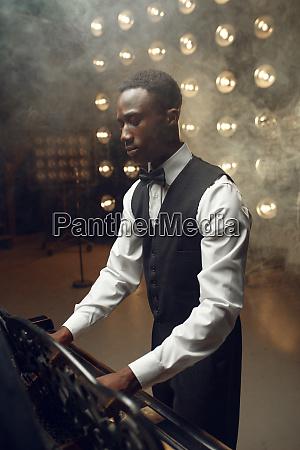 ebony grand piano player playing on