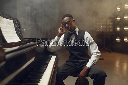 ebony grand piano player jazz performer