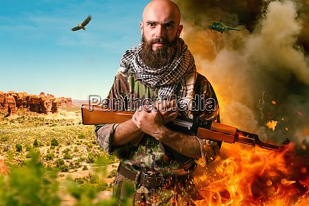 bearded terrorist in uniform holds rifle