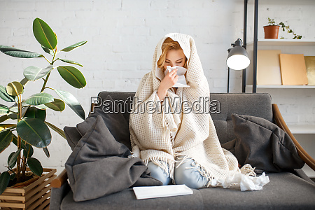 sick woman sitting with kerchief under