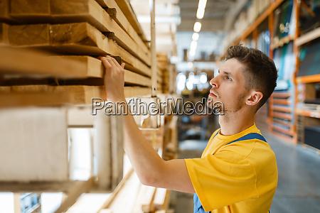 builder choosing repair materials hardware store