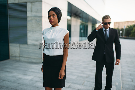 bodyguard in sunglasses and black business