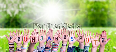 children hands fruehjahrsputz means spring cleaning