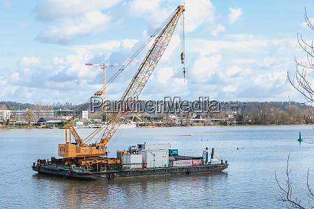 floating construction barge with a crane