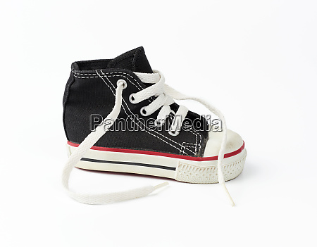 black textile childrens sneaker with white