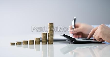 man calculating finances
