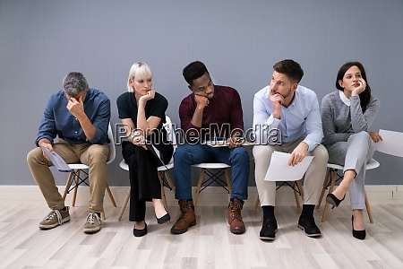 bored applicants waiting for job interview