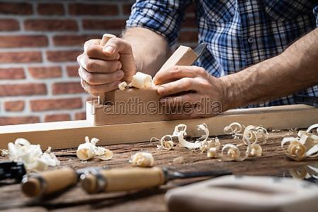 carpenter using jack plane
