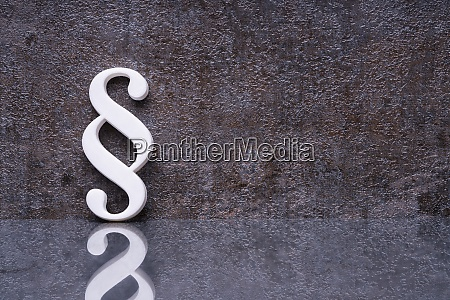 paragraph symbol leaning on dark wall