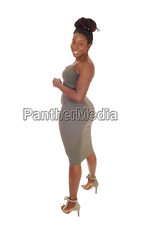 curvy young african woman standing in