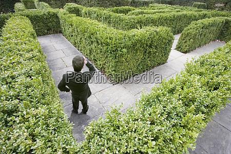 businessman lost in a maze