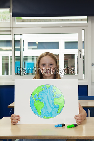 primary school girl holding placrd with