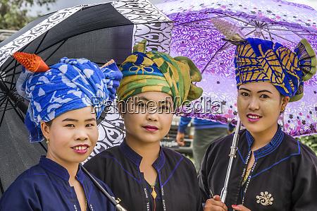 pao tribal women wearing colourful head