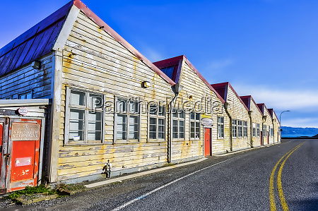 weathered buildings along a road with