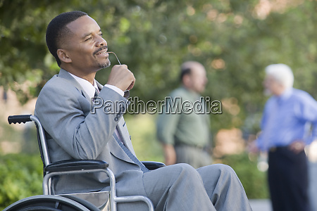 smiling businessman on wheelchair