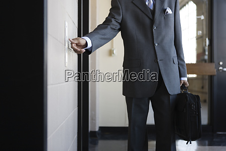 a young business man pressing push