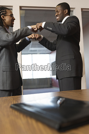 young businessmen smiling
