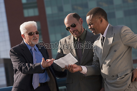 businessmen going over a document together