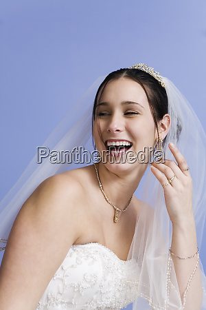 cheerful bride in bridal gown