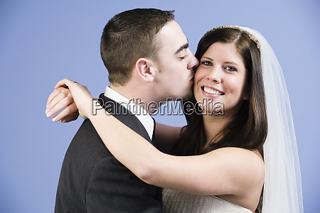 a groom kissing his bride